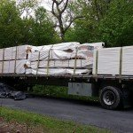 tractor trailer truck delivering log home, Timberhaven, delivery day, log homes, log cabin, custom built log home, laminated, kiln-dried