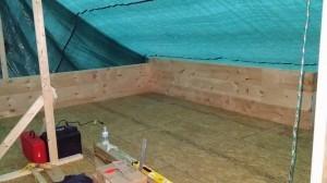 tarp covers log row 1-3, log home construction site, pre-cut logs, laminated, kiln dried, Timberhaven, custom built log home, home builder