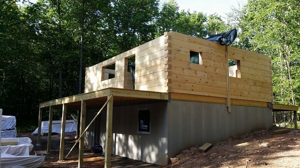 log home under construction, Timberhaven, custom built log home, kiln dried, home builder, Timberhaven, laminated