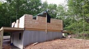log home under construction, pre-cut logs, laminated, kiln dried, Timberhaven, custom built log home, home builder