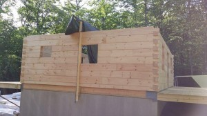 dovetail corner assembly, log home construction site, pre-cut logs, laminated, kiln dried, Timberhaven, custom built log home, home builder