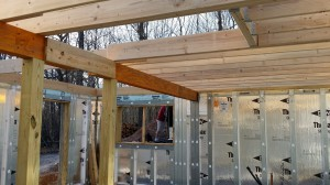 support posts and decking for basement, custom built log home, Timberhaven, kiln dried, laminated, log cabins