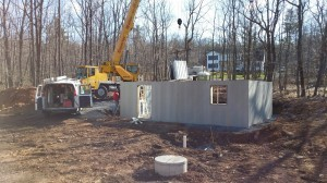 crane used to set superior wall basement, custom built log home, Timberhaven, kiln dried, laminated, log cabins