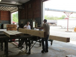 log being inspected, Log Homes Council grading standards, Timberhaven, custom built log home, log homes, log cabin, kiln-dried