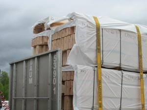 strapping down the log packs, Timberhaven, delivery day, log homes, log cabin, custom built log home, laminated, kiln-dried
