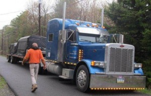 tarped tractor trailer truck, Timberhaven, delivery day, log homes, log cabin, custom built log home, laminated, kiln-dried