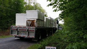 truck of log home materials to be unloaded, Timberhaven, delivery day, log homes, log cabin, custom built log home, laminated, kiln-dried