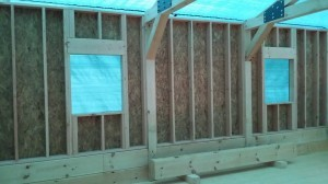 conventionally framed shed dormer, log home under construction, custom built, Timberhaven, kiln dried, laminated, heavy timbered system