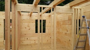 beams to support second floor and interior wall framing, log home construction, Timberhaven, custom built log homes, kiln dried, laminated