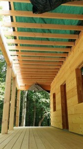 lower side of porch ceiling, log home under construction, custom built log home, Timberhaven, kiln dried, laminated, heavy timbered system