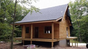 shingles on newly constructed roof, beam & purlin roof system, custom built log home, weather-tight package, laminated, kiln-dried, Timberhaven Log Homes