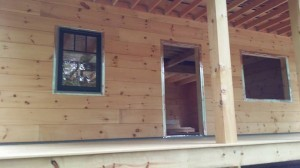windows and doors being prepped for installation, log home under construction, weather-tight phase, kiln-dried, laminated, Timberhaven