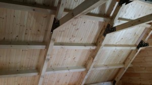 beam & pulin roof system, log home under construction, custom built log home, Timberhaven, kiln dried, laminated, heavy timbered system