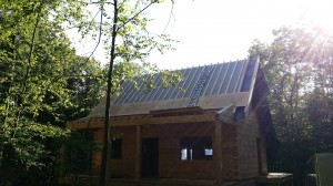 roof construction, furring strips in place, custom built log home, log home under construction, Timberhaven Log Homes, laminated, kiln dried, weather-tight