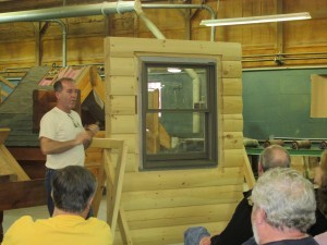 window installation demonstration, log home construction workshop, Timberhaven, laminated, weather-tight phase, log home under construction, custom built, kiln-dried, laminated