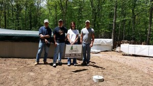 customers with local rep and owner of Timberhaven Log Homes, log homes, custom built log home, under construction, customer support, planning log home, laminated, kiln dried