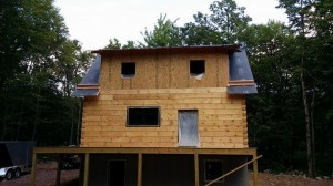 rear of log home home, shed dormer, working toward weather-tight phase, Timberhaven, log homes, log home under construction, custom built log home, laminated, kiln-dried, White Pine