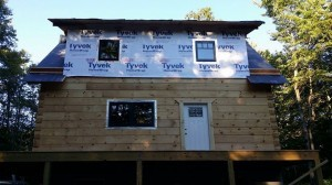 conventionally framed shed dormer with house wrap, log home construction progress, Timberhaven, custom built log home, laminated, kiln dried