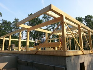 cantilever over first floor, balcony over first floor, post and beam construction, under construction, log homes, log cabins, log cabin kits, Timberhaven, post and beam cabin, post and beam cabin kits, kiln dried, laminated