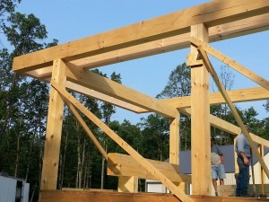 post and beams braced with 2x4s on first level of home, post and beam construction, under construction, log homes, log cabins, log cabin kits, Timberhaven, post and beam cabin, post and beam cabin kits, kiln dried, laminated