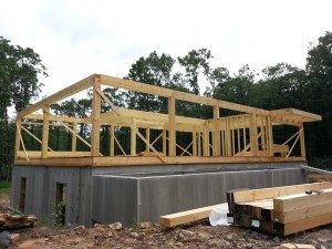 first floor framing, post and beam home, under construction, log homes, log cabins, log cabin kits, Timberhaven, post and beam cabin, post and beam cabin kits, kiln dried, laminated