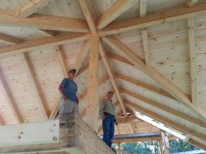 builders in awe of beautiful roof on post and beam home, heavy timbers, tongue and groove finish, under construction, Timberhaven Log Homes, log cabins, log cabin kits, log kits, laminated, kiln dried