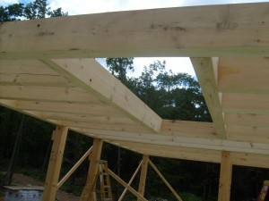 heavy timber loft joists in place and cut out for stair placement, post and beam construction, under construction, log homes, log cabins, log cabin kits, Timberhaven, post and beam cabin, post and beam cabin kits, kiln dried, laminated