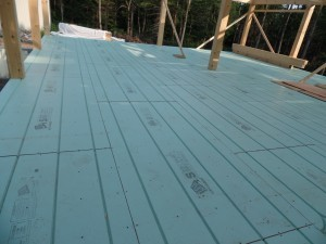 Warmboard in place on subfloor, in-floor radiant heat, post and beam construction, under construction, log homes, log cabins, log cabin kits, Timberhaven, post and beam cabin, post and beam cabin kits, kiln dried, laminated