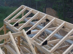heavy timber roof system with gusset plates, post and beam home design, under construction, log homes, log cabins, log kits, Timberhaven, laminated, kiln dried