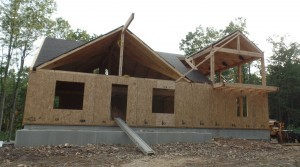 first floor SIPs installed to custom post and beam home, post and beam homes, under construction, log homes, log cabin, log cabin kits, Timberhaven Log Homes, laminated, kiln dried, heavy timbers, SIPs