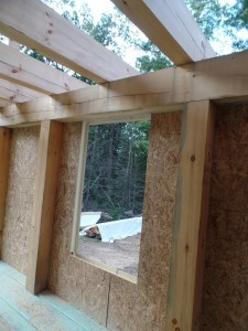 interior shot of SIP panels in place, first floor SIPs installed to custom post and beam home, post and beam homes, under construction, log homes, log cabin, log cabin kits, Timberhaven Log Homes, laminated, kiln dried, heavy timbers, SIPs