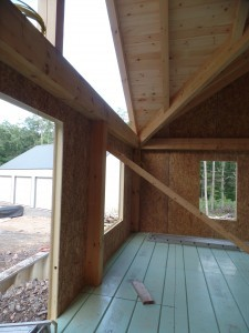 interior shot of first floor SIPs installed to custom post and beam home, post and beam homes, under construction, log homes, log cabin, log cabin kits, Timberhaven Log Homes, laminated, kiln dried, heavy timbers, SIPs