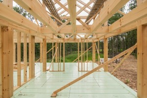 beam pocket in conventionally framed wall, post and beam home under construction, Timberhaven, log home, log homes, log cabin, laminated, kiln dried