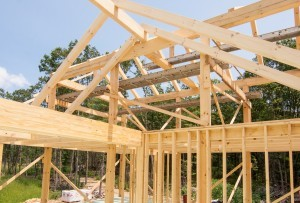 heavy timber rafters from ridge beam in roof system, post and beam home design, under construction, log homes, log cabins, log kits, Timberhaven, laminated, kiln dried