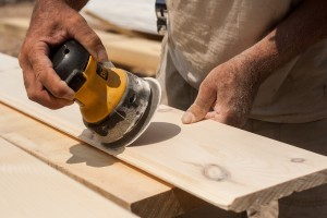 builder sanding tongue and groove, Timberhaven Log Homes, log home, log cabins, log cabin kits, post and beam homes, under construction, kiln dried, laminated