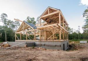construction site of post and beam home with roof, Timberhaven Log Homes, log home, log cabins, log cabin kits, post and beam homes, under construction, kiln dried, laminated