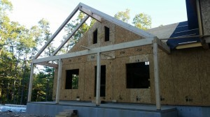 post and beam porch under construction on post and beam home, compound cuts, White Pine, post and beam porch, under construction, solid wood home, log homes, log cabins, log cabin kit, Pennsylvania home, Timberhaven, laminated, kiln dried