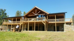 rear porch and deck of custom log home, Timberhaven log home in Ararat, VA, JB Kerns wounded warrier project, honored to support, Timberhaven Log Homes, log home, log cabin, log cabins, log kits, laminated, kiln dried