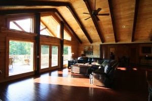 vast wall of glass overlooking rear deck, Timberhaven log home in Ararat, VA, JB Kerns wounded warrier project, honored to support, Timberhaven Log Homes, log home, log cabin, log cabins, log kits, laminated, kiln dried