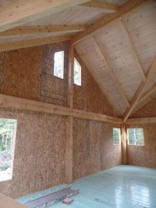 inside of custom post and beam home construction, post and beam homes, post and beam home design, Timberhaven Log Homes, log homes, log home, log cabins, log cabin kits, laminated, kiln dried, under construction, two-story post and beam home