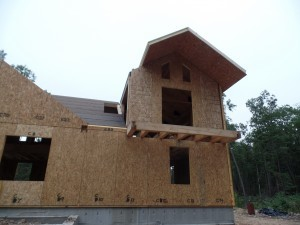 two-story post and beam home, roof SIPs being installed on custom post and beam home construction, post and beam homes, post and beam home design, Timberhaven Log Homes, log homes, log home, log cabins, log cabin kits, laminated, kiln dried, under construction