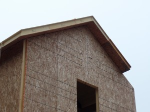 two-story post and beam home, closeup of roof SIPs being installed on custom post and beam home construction, post and beam homes, post and beam home design, Timberhaven Log Homes, log homes, log home, log cabins, log cabin kits, laminated, kiln dried, under construction