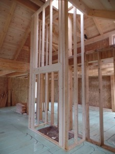 conventional construction of fireplace, Timberhaven Log Homes, log home, log cabin kits, log cabins, post and beam homes, custom wood home, design ideas, laminated, kiln dried, under construction