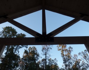 King Post Truss on porch of post and beam home, post and beam porch, under construction, solid wood home, log homes, log cabins, log cabin kit, Pennsylvania home, Timberhaven, laminated, kiln dried