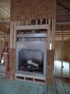 insert into custom fireplace, custom wood home, Timberhaven log homes, log cabin kit, log cabins, kiln dried, laminated, no shop package, fireplace