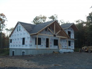 exterior post and beam home under construction, post and beam wood home, custom design, dream home, log homes, log cabin homes, log cabin kits, log cabins, Timberhaven Log Homes, laminated, kiln dried