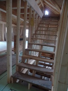 stairs from first to second level, post and beam house, laminated logs, heavy timbers, Timberhaven, log homes, log cabin kits, kiln dried
