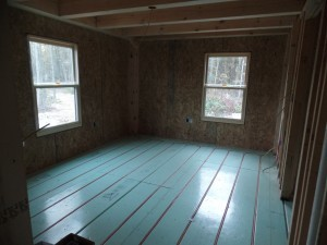 Warmboard in-floor radiant heating in bedroom, PEX installation, post and beam wood home, custom design, dream home, log homes, log cabin homes, log cabin kits, log cabins, Timberhaven Log Homes, laminated, kiln dried