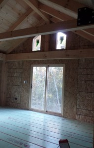 double sliding doors to private balcony, two-story home, post and beam house, laminated logs, heavy timbers, Timberhaven, log homes, log cabin kits, kiln dried
