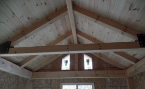 cozy master bedroom with cathedral ceiling, two-story home, post and beam house, laminated logs, heavy timbers, Timberhaven, log homes, log cabin kits, kiln dried